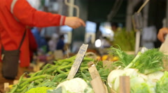 People making shopping at the open-air market: buying vegetables Stock Footage