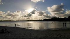 Tourist enjoying on beach of Port Louis at dusk, Mauritius Stock Footage