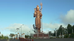 Bronze statue of Lord Shiva near a temple, Port Louis, Mauritius Stock Footage