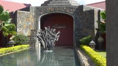 Fountain in garden of Rhumerie De Chamarel distillery in Chamarel, Mauritius Stock Footage