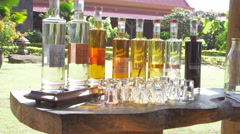 Stock Video Footage of Various rum bottles kept in display in Rhumerie De Chamarel distillery,
