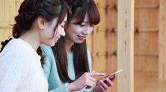 Young Japanese women using smartphone at foot spa in Kawagoe, Saitama Stock Footage