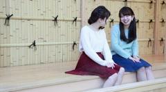 Young Japanese women enjoying foot spa in Kawagoe, Saitama Prefecture, Japan Stock Footage