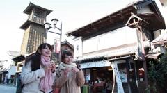 Young Japanese women enjoying trip to Kawagoe, Saitama Prefecture, Japan Stock Footage