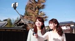 Young Japanese women taking a selfie in Kawagoe, Saitama Prefecture, Japan Stock Footage