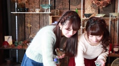 Young Japanese women checking art pieces in a glass workshop in Kawagoe, Saitama Stock Footage