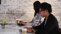 Young business people working together in a modern office Stock Footage