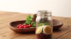 Preparing jar salad Stock Footage