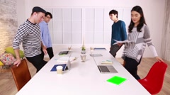 Multi-ethnic young business people working together in a modern office Stock Footage