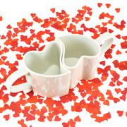 Two hearts shaped cups composition - stock photo
