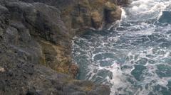 Water splashing through the Arahoho Blowhole on the coastline of Papeete, Stock Footage