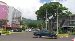 Vehicle moving on road, Papeete, Tahiti, French Polynesia - stock footage