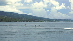Tourists kayaking in sea, Point Venus, Papeete, Tahiti, French Polynesia Stock Footage