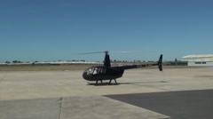 Pilot preparing to fly Robinson R44 Raven Stock Footage