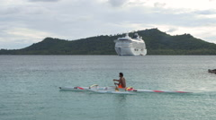 View of ferry and kayakers paddling in sea, Bora Bora Island, French Polynesia Stock Footage