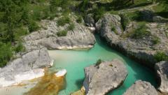 Aerial - A stream of water gushing from a canyon into the green pool - stock footage