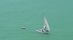 Man sailing in sailboat near Bay of Islands, North Island, New Zealand Stock Footage