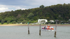 Ferry moving away from the dock at Bay of Islands , North Island, New Zealand Stock Footage