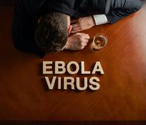 Phrase Ebola Virus and devastated man composition - stock photo