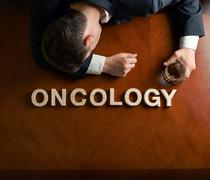 Word Oncology and devastated man composition - stock photo