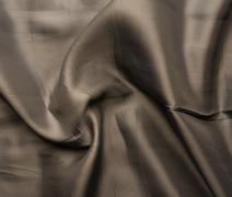 Brown silk cloth material fragment Stock Photos