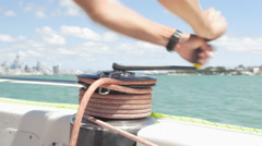 Man adjusting the rigging knots on yacht, Auckland, New Zealand Stock Footage