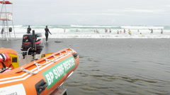 View of rescue boat and people having fun on beach, Auckland, North Island, New Stock Footage