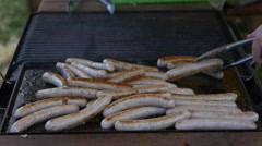 Sausages being fried in pan, Matamata, New Zealand Stock Footage