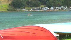 Men paddle boarding in sea, Mount Maunganui, New Zealand Stock Footage