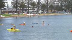 Local children having fun in sea, Mount Maunganui, New Zealand Stock Footage