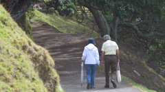 Mature couple taking a walk in park, Mount Maunganui, New Zealand Stock Footage