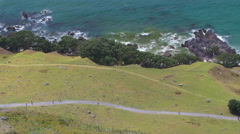 Local people walking on The Mount in Mount Maunganui, New Zealand Stock Footage