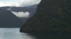 WS POV View of Milford Sound surrounded with mountains, South Island, New - stock footage