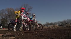 Motocross racers on dirt track Stock Footage