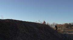 Motocross racer on dirt track Stock Footage