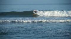 Surfer surfing in sea, Malibu, California, USA Stock Footage