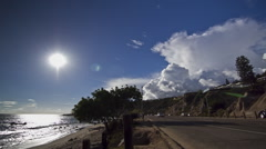 View of sky and vehicles moving on highway next to sea coast, Malibu, Stock Footage