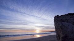 People on beach at sunset, Malibu, California, USA Stock Footage