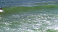 Surfers surfing in sea, Malibu, California, USA - stock footage