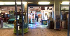 People at Playland Arcade, Santa Monica, California, USA Stock Footage