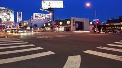 Traffic moving on Sunset Boulevard street at night, Hollywood, Los Angeles, - stock footage