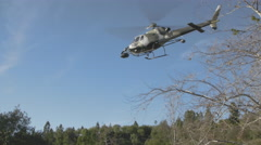 Military helicopter landing on field Stock Footage