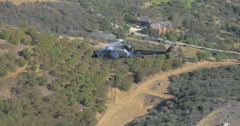 Military helicopter looking out for criminal's vehicle - stock footage