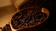 Coffee beans in a wooden plate Stock Footage