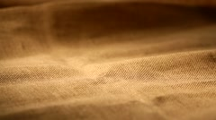 Coffee beans falling on linen bag Stock Footage