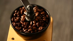Grinding coffee beans with mill Stock Footage