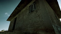 4K abandoned derelict house exterior in city outskirts motion control timelapse Stock Footage