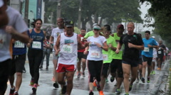 City Marathon, Runners Run Marathon, outdoor, competition.  Rainy day Stock Footage
