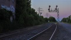 Hazy pink horizon on the train tracks Stock Footage
