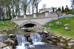An artificial waterfall in a city park Stock Photos